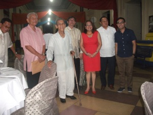 Postmaster General Josie dela Cruz with stamp collectors and war veteran