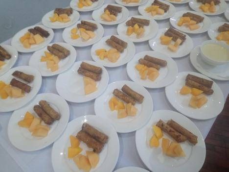 fried-turon-and-slices-of-fruits